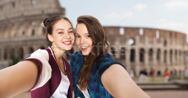 happy teenage girls taking selfie over coliseum Stock photo © dolgachov
