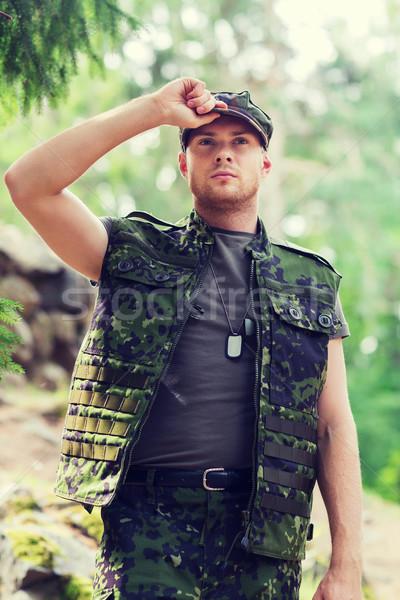 Jovem soldado floresta guerra exército pessoas Foto stock © dolgachov