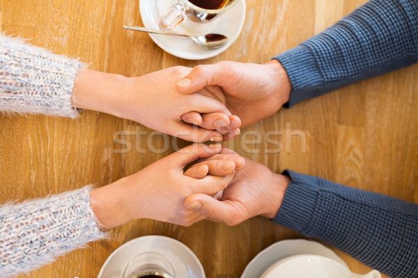 close up of couple holding hands at restaurant Stock photo © dolgachov