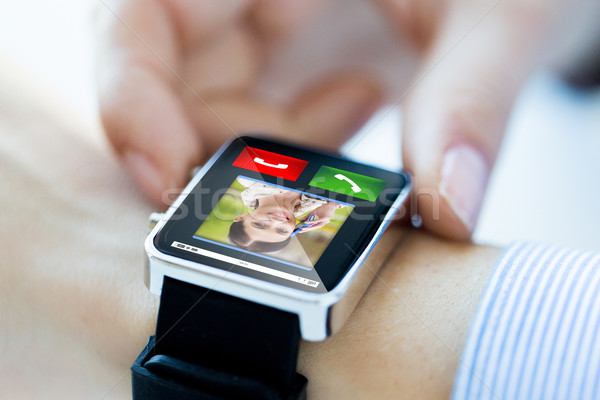close up of hands with incoming call on smartwatch Stock photo © dolgachov