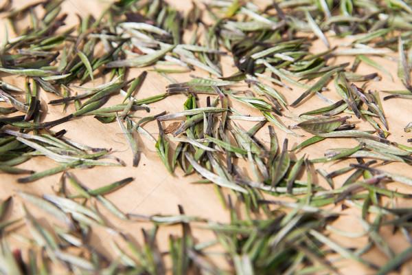 close up of tea raw drying Stock photo © dolgachov