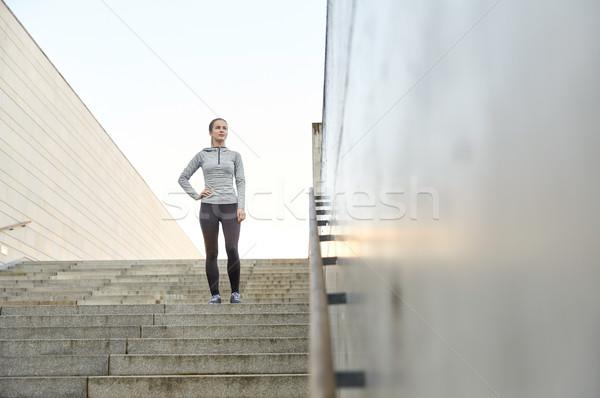 Sportos nő áll város lépcsősor fitnessz Stock fotó © dolgachov