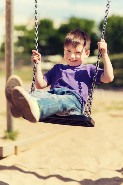 Szczęśliwy mały chłopca huśtawka boisko lata Zdjęcia stock © dolgachov