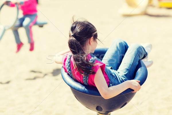 Közelkép lány játszik gyerekek játszótér nyár Stock fotó © dolgachov
