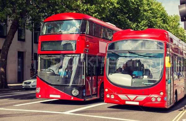 city street with red double decker buses in london Stock photo © dolgachov