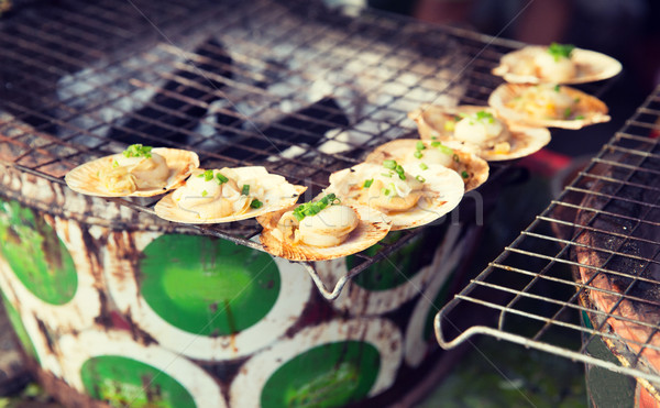 oysters or seafood grill at asian street market Stock photo © dolgachov