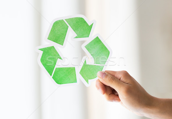 close up of hand holding green recycle symbol Stock photo © dolgachov