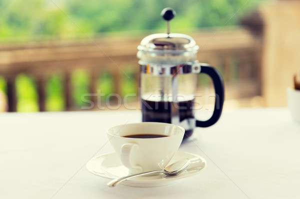 cup of coffee and french press on table  Stock photo © dolgachov