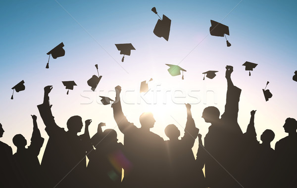 silhouettes of students throwing mortarboards Stock photo © dolgachov