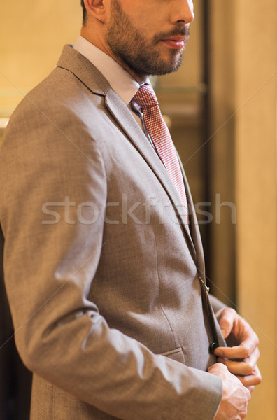 Homem terno roupa armazenar venda Foto stock © dolgachov