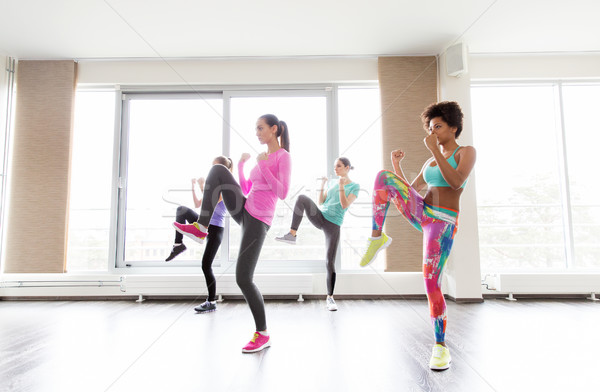 group of women working out fighting stance in gym Stock photo © dolgachov