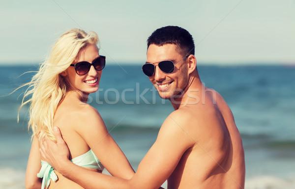 Feliz casal sessão verão praia Foto stock © dolgachov