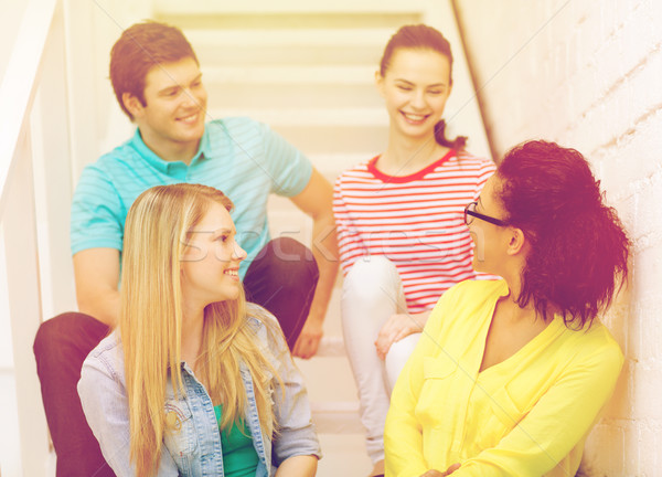 smiling teenagers hanging out Stock photo © dolgachov