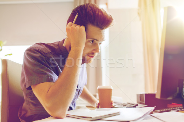 creative male office worker with coffee thinking Stock photo © dolgachov