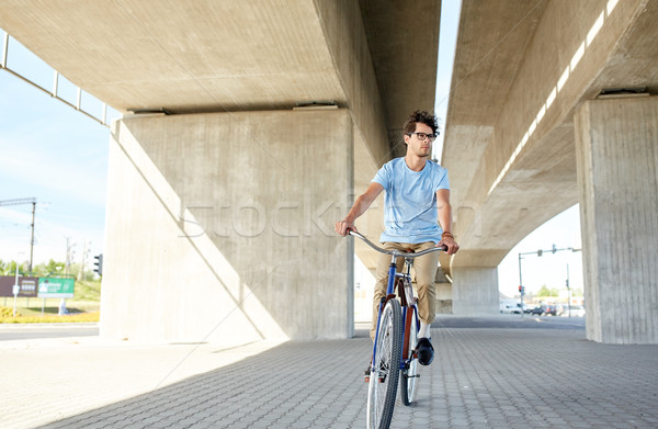 Stock photo: young hipster man riding fixed gear bike