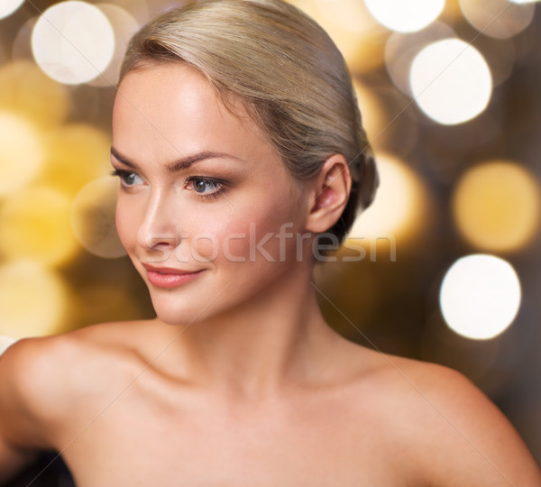 Stock photo: close up of young woman sitting in bath towel