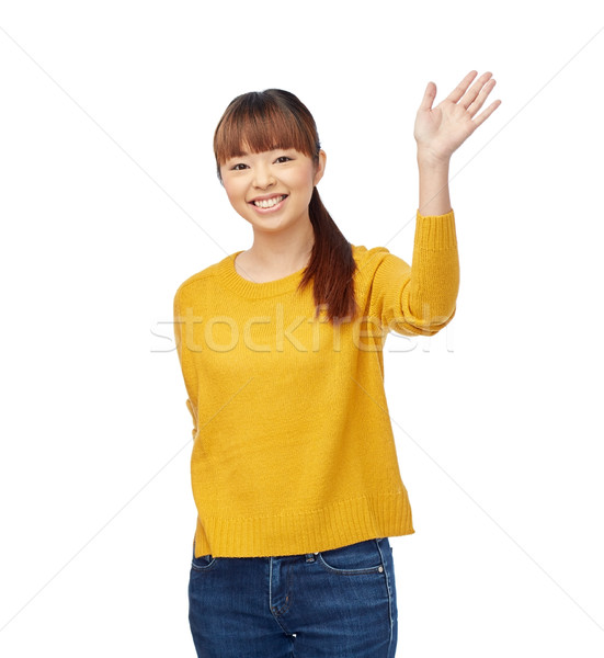happy asian young woman waving hand over white Stock photo © dolgachov