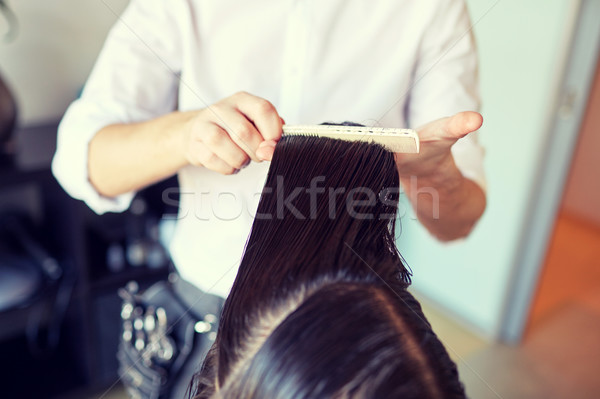 male stylist hands combing wet hair at salon Stock photo © dolgachov