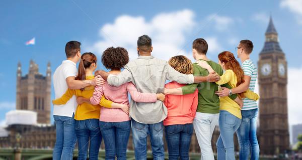 international group of people hugging over london Stock photo © dolgachov