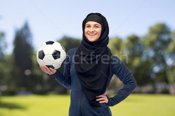 happy muslim woman in hijab with football Stock photo © dolgachov