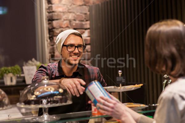 man or barman serving customer at vegan cafe Stock photo © dolgachov