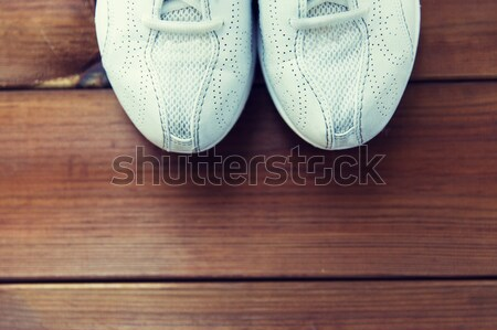 close up of sneakers on wooden floor Stock photo © dolgachov