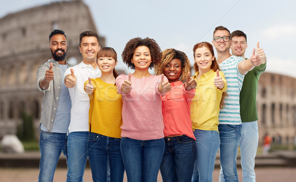 happy people showing thumbs up over coliseum Stock photo © dolgachov