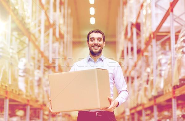happy man with cardboard parcel box at warehouse Stock photo © dolgachov