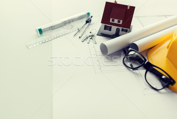 Stock photo: close up of blueprint with tools and house keys