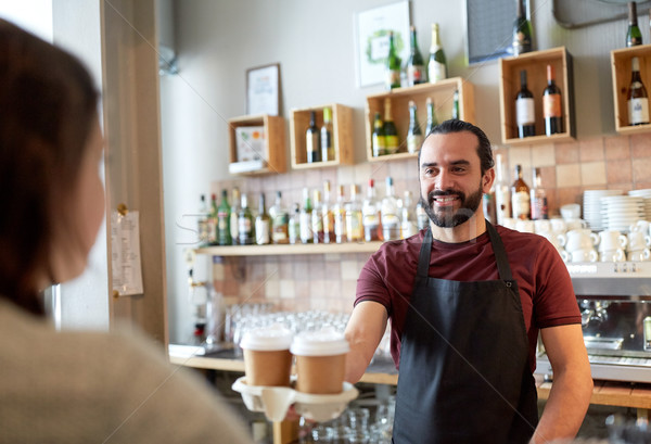 Stock photo: man or waiter serving customer in coffee shop