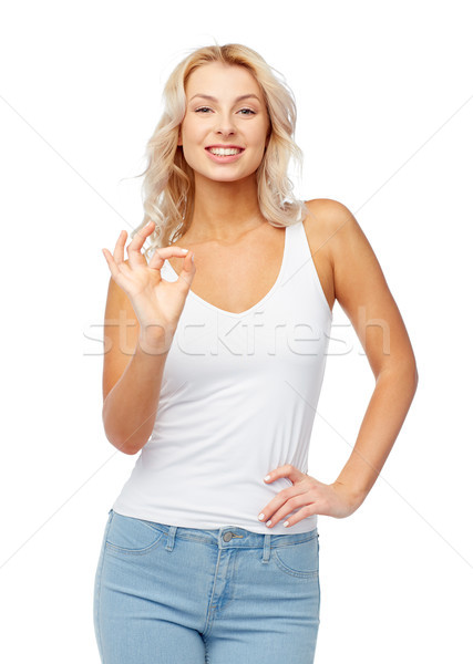 happy young woman showing ok hand sigh Stock photo © dolgachov