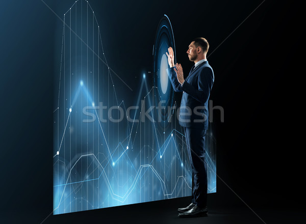 businessman working with virtual chatrs projection Stock photo © dolgachov
