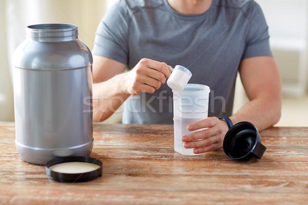 Man eiwit schudden fles jar Stockfoto © dolgachov