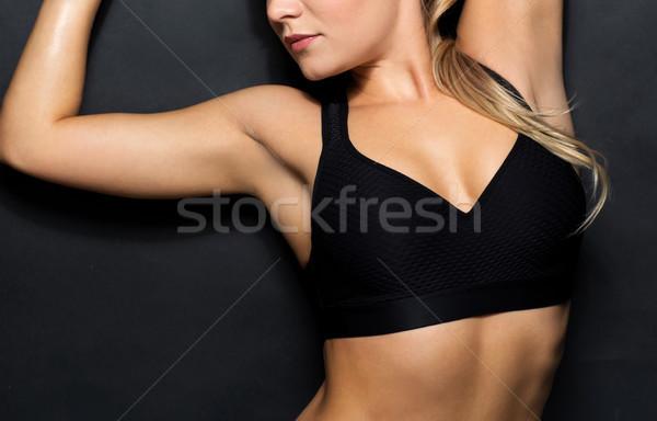 Kobieta czarny odzież sportowa stwarzające sportu Zdjęcia stock © dolgachov
