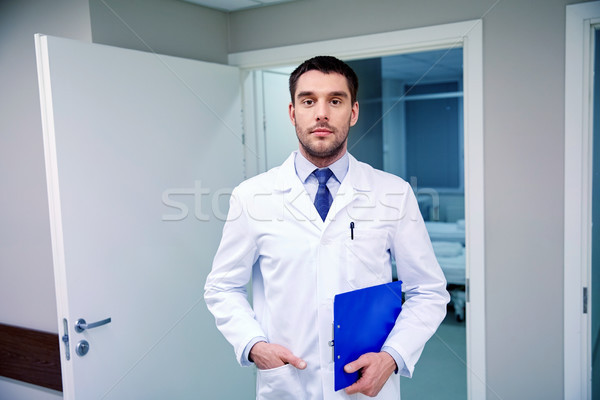 doctor with clipboard at hospital corridor Stock photo © dolgachov