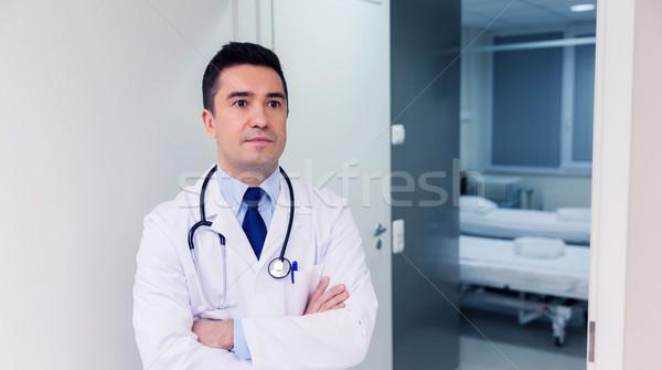 doctor in white coat at hospital Stock photo © dolgachov