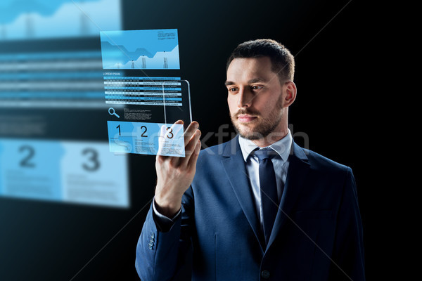 businessman with smartphone and exchange charts Stock photo © dolgachov