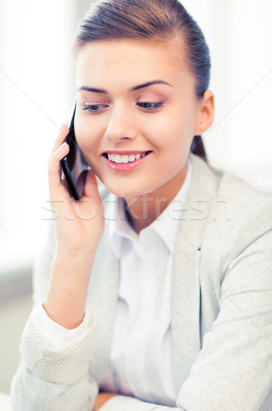 businesswoman with smartphone in office Stock photo © dolgachov