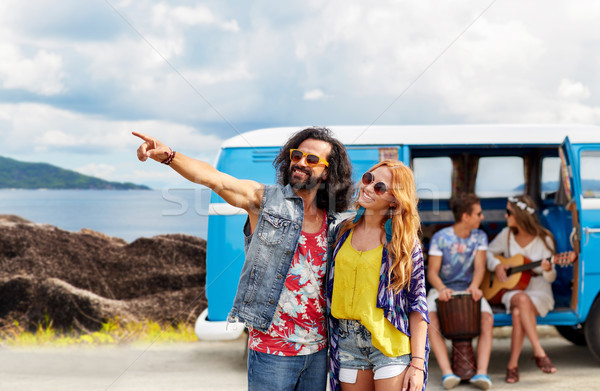 happy hippie couples and minivan on island Stock photo © dolgachov