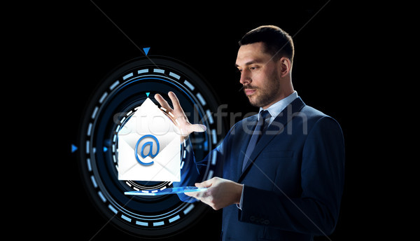 businessman with tablet pc and e-mail hologram Stock photo © dolgachov