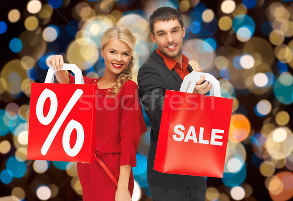 couple with sale and discount sign on shopping bag Stock photo © dolgachov