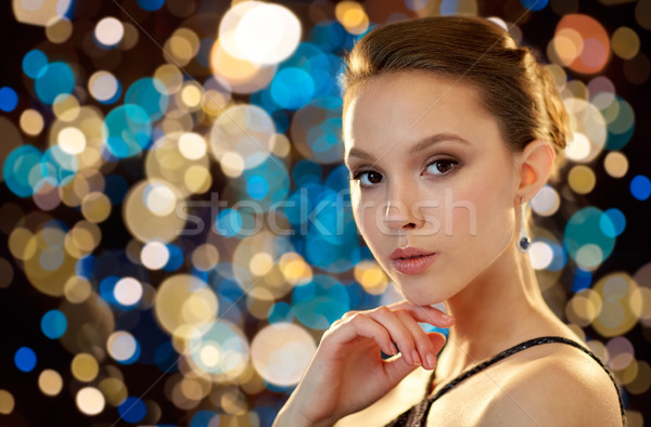 beautiful young asian woman with earring Stock photo © dolgachov