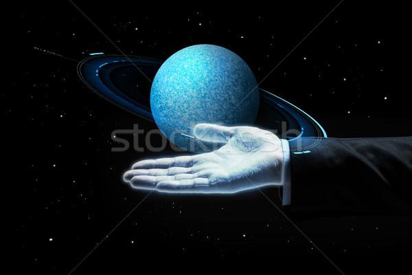 close up of businessman with planet hologram Stock photo © dolgachov