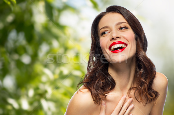 beautiful laughing young woman with red lipstick Stock photo © dolgachov