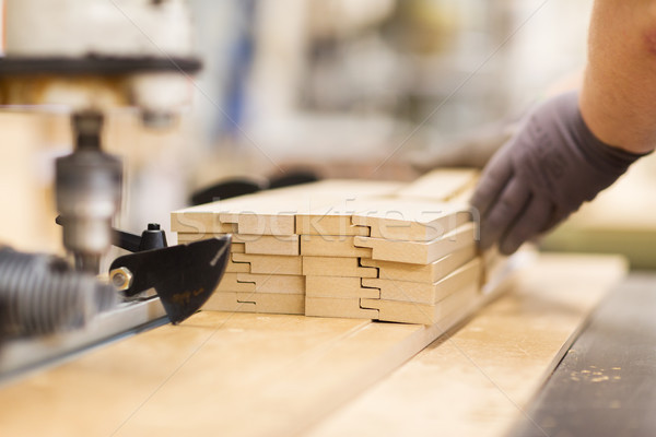 close up of carpenter hand with boards at factory Stock photo © dolgachov