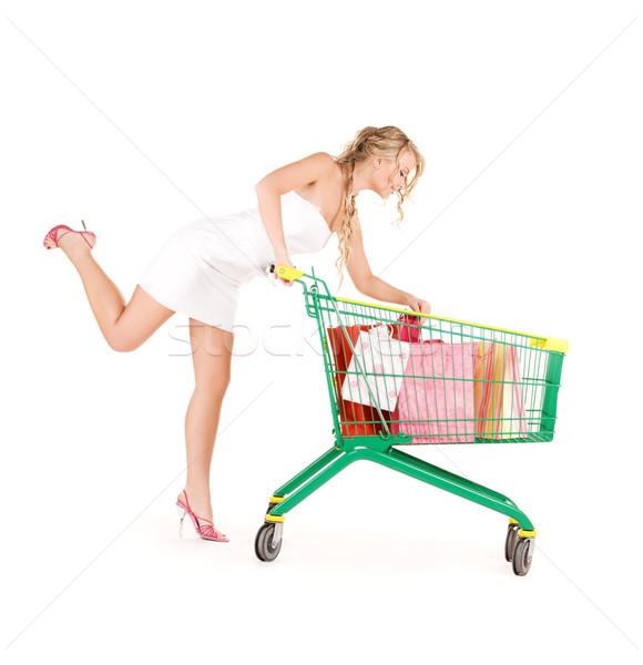 Klant gelukkig vrouw winkelwagen witte glimlachend Stockfoto © dolgachov