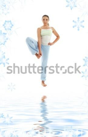 yoga standing on white sand #3 Stock photo © dolgachov