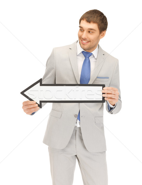 businessman with direction arrow sign Stock photo © dolgachov