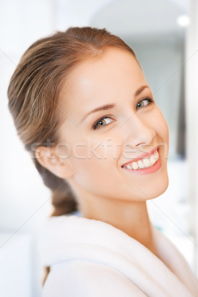 beautiful woman in white bathrobe Stock photo © dolgachov