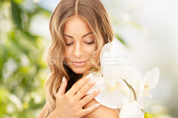 Stock photo: beautiful woman with orchid flower